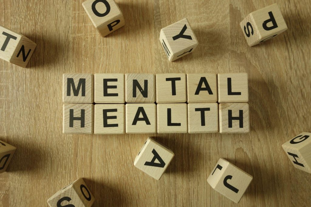 Mental health text from wooden blocks on desk